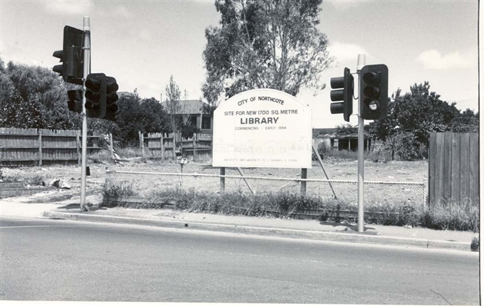 Image of the site for Northcote Library on Separation Street with a sign outlining the beginning of construction